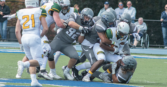 The Greyhounds' defense stops a McDaniel College running back in the 2017 home opener.