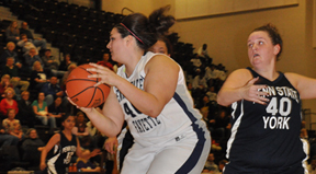 Stephanie Longo grabs a rebound in Fayette's quarterfinal win over Penn State York