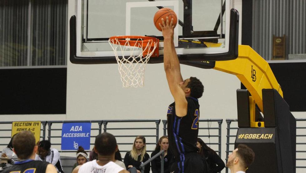 Michael Bryson goes in for a slam dunk in the first half of UCSB's 80-70 overtime loss at Long Beach State on Thursday.