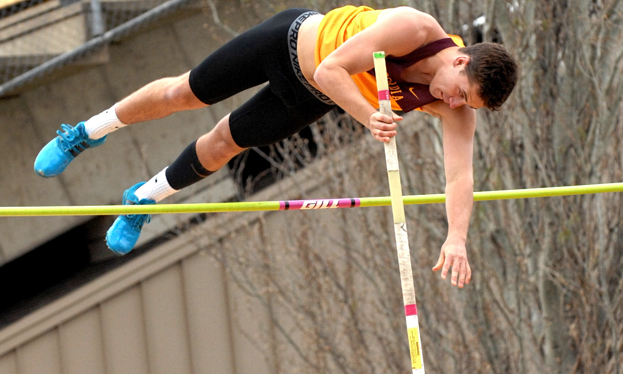 Sophomore Eli Beachy clears the bar in the pole vault on his way to winning the event at the annual Cobber Twilight Meet.