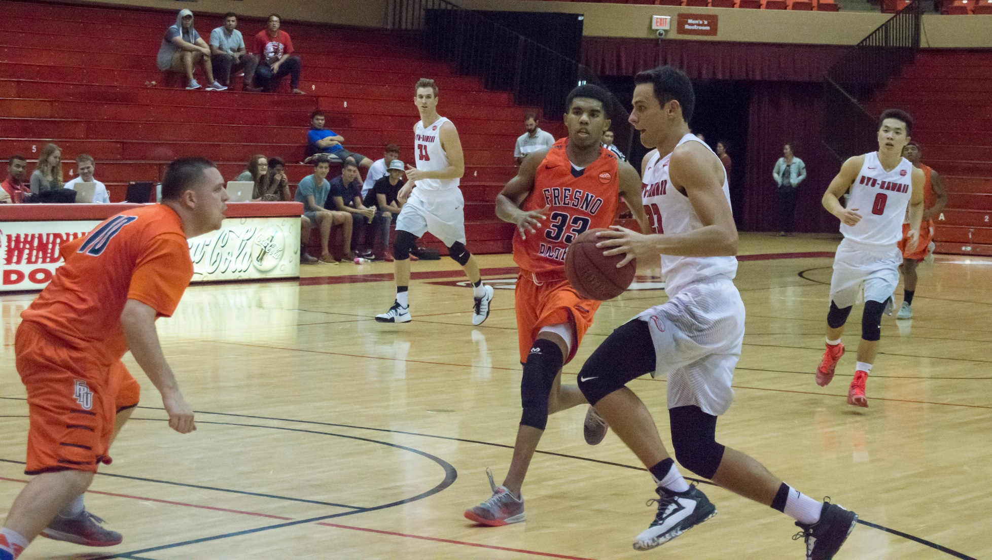 Caeleb Roney drives the lane in the second half against Fresno Pacific.