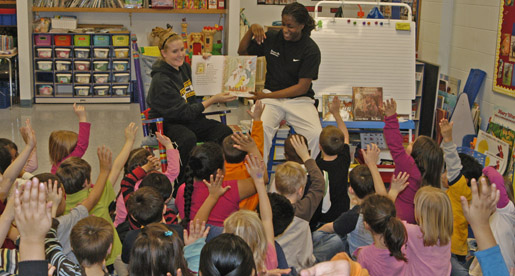 Women's Basketball reads to Kindergarten classes at Jere Whitson school