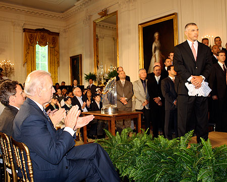 Vice-President Joe Biden looks on from the front row.