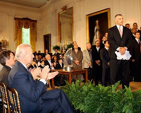 Vice-President Joe Biden looks on from the front row.