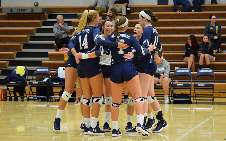 The Greyhounds celebrate a point in the 2018 season opener versus Baldwin-Wallace (Ohio) University.