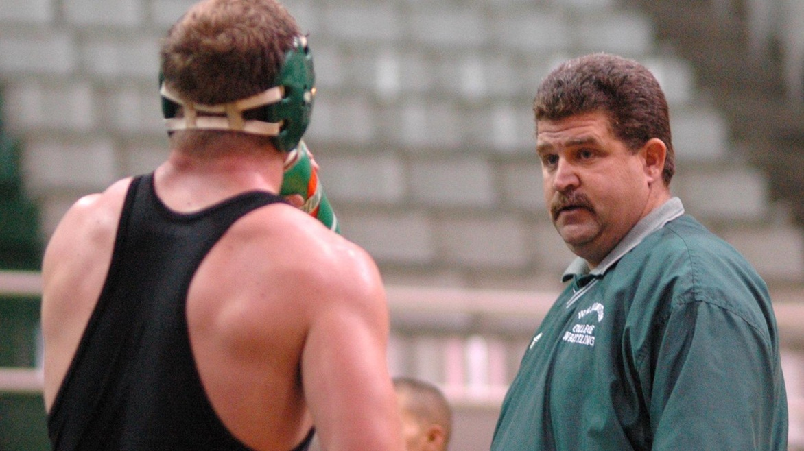 Jim Marsh, pictured right, coaches during a wrestling match in Hermann Court.