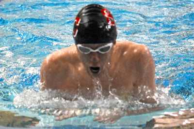 McKim wins 100 breaststroke, Storm solid at opening meet