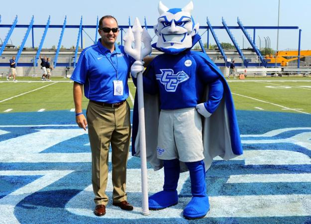Director of Athletics Paul Schlickmann, alongside Kizer the Blue Devil