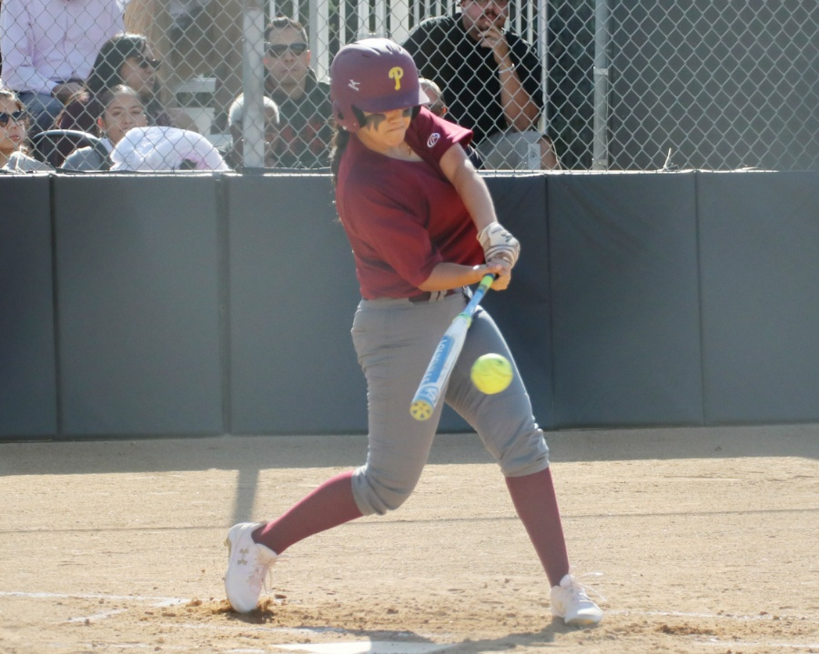 Lancer first baseman Amanda Flores drives a ball during a recent game, photo by Richard Quinton.