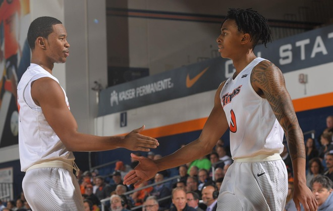 Jamal Smith and Kyle Allman, Jr. slapping hands