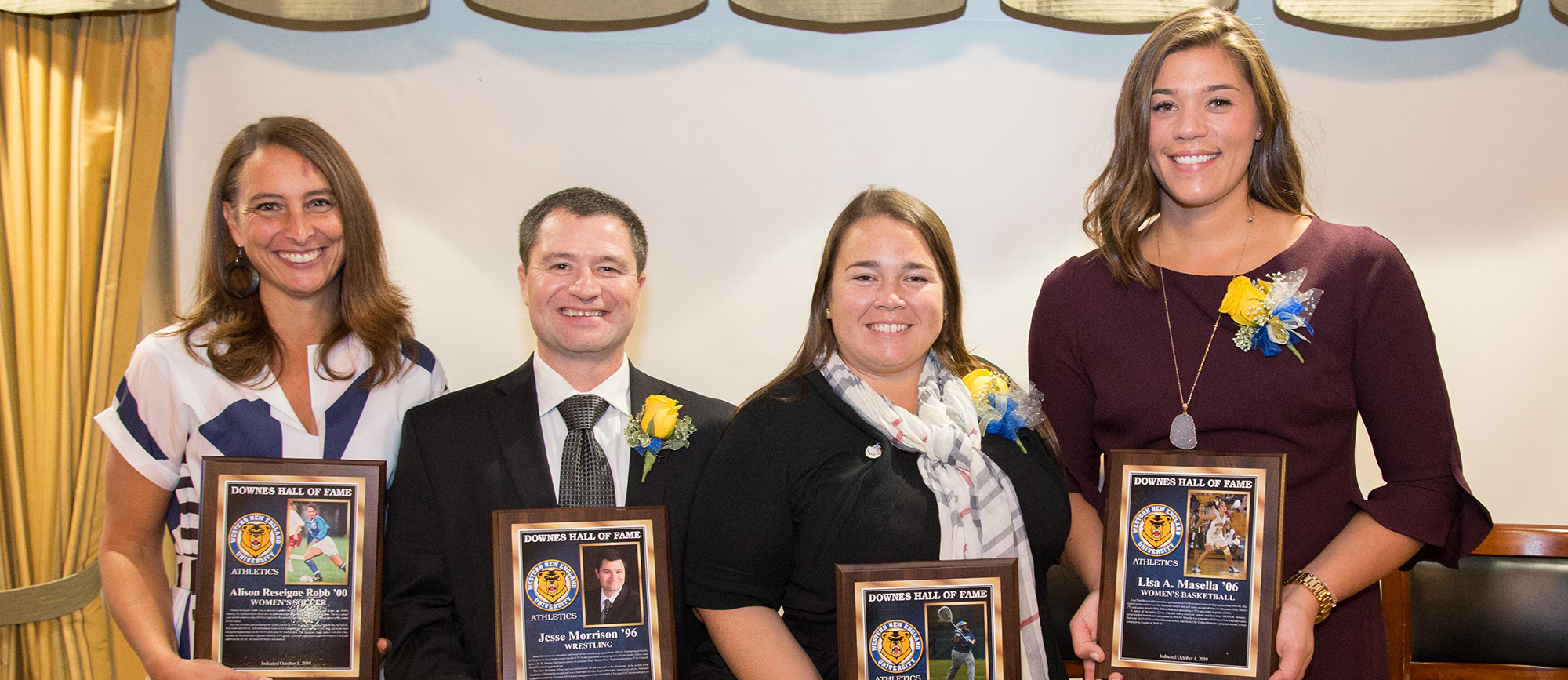 From Left: Alison (Reseigne) Robb '00 (women's soccer), Jesse Morrison '96 (wrestling), Tara (Cushman) Amato '06 (women's lacrosse) & Lisa (Masella) Saunders '06 (women's basketball) were inducted into the Downes Athletic Hall of Fame on Friday night. (Photo by Chris Marion)
