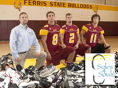 Pictured are (left to right): Dr. Jeff Mossel and FSU football players Chad Wilson, Damien Miller and Matt Schuelke (Photo by Bill Bitzinger, FSU Photographic Services)