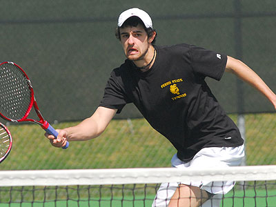 Steven Roberts eyes the ball in Sunday's number one doubles match (Photo by Rob Bentley)