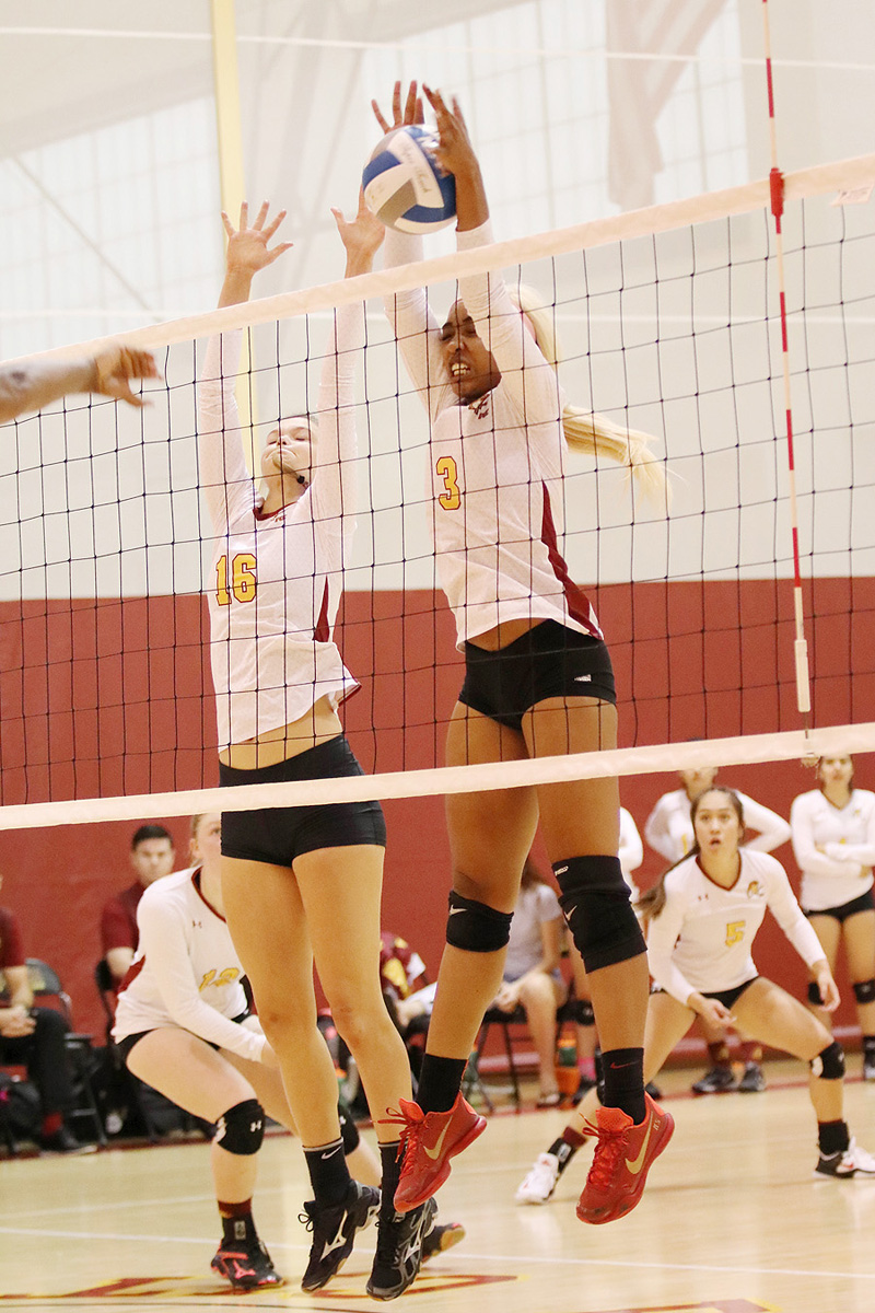 Rachel Johnson (left) and Kendall Schmedes (right) go up for a block during PCC's four-set win over Riverside at Hutto-Patterson Gym Saturday.