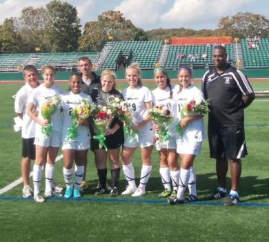 Coach Roche Reaches 100 Wins on Senior Day