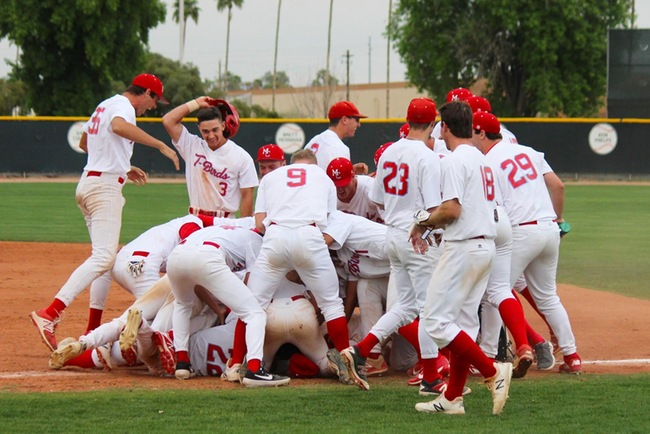 The T-Birds dog-pile after beating Central Arizona, 3-2, in the bottom of the ninth inning.
