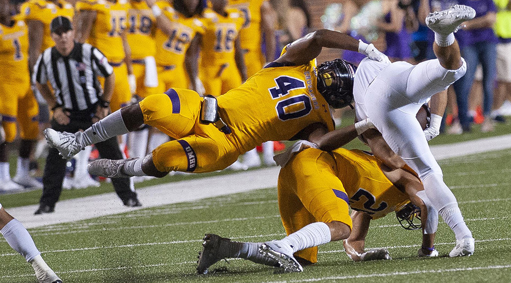 De Jackson flies parallel to the ground to help bring down a Hardin-Simmons ballcarriers. (UMHB athletics photo)