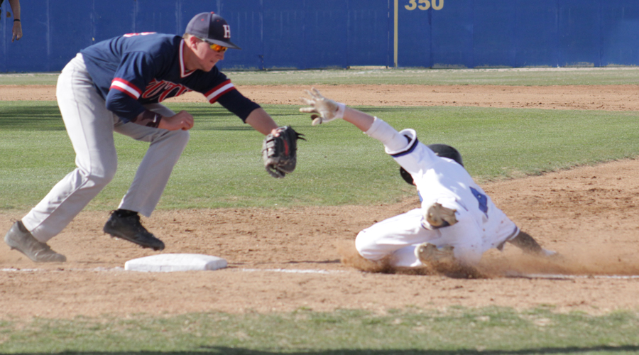 Blue Dragon first baseman Zach Baxley tags out a Barton baserunner in the second inning of a 14-4 loss to the No. 18 Cougars on Tuesday in Great Bend. (Photo courtesy Barton Sports Information)