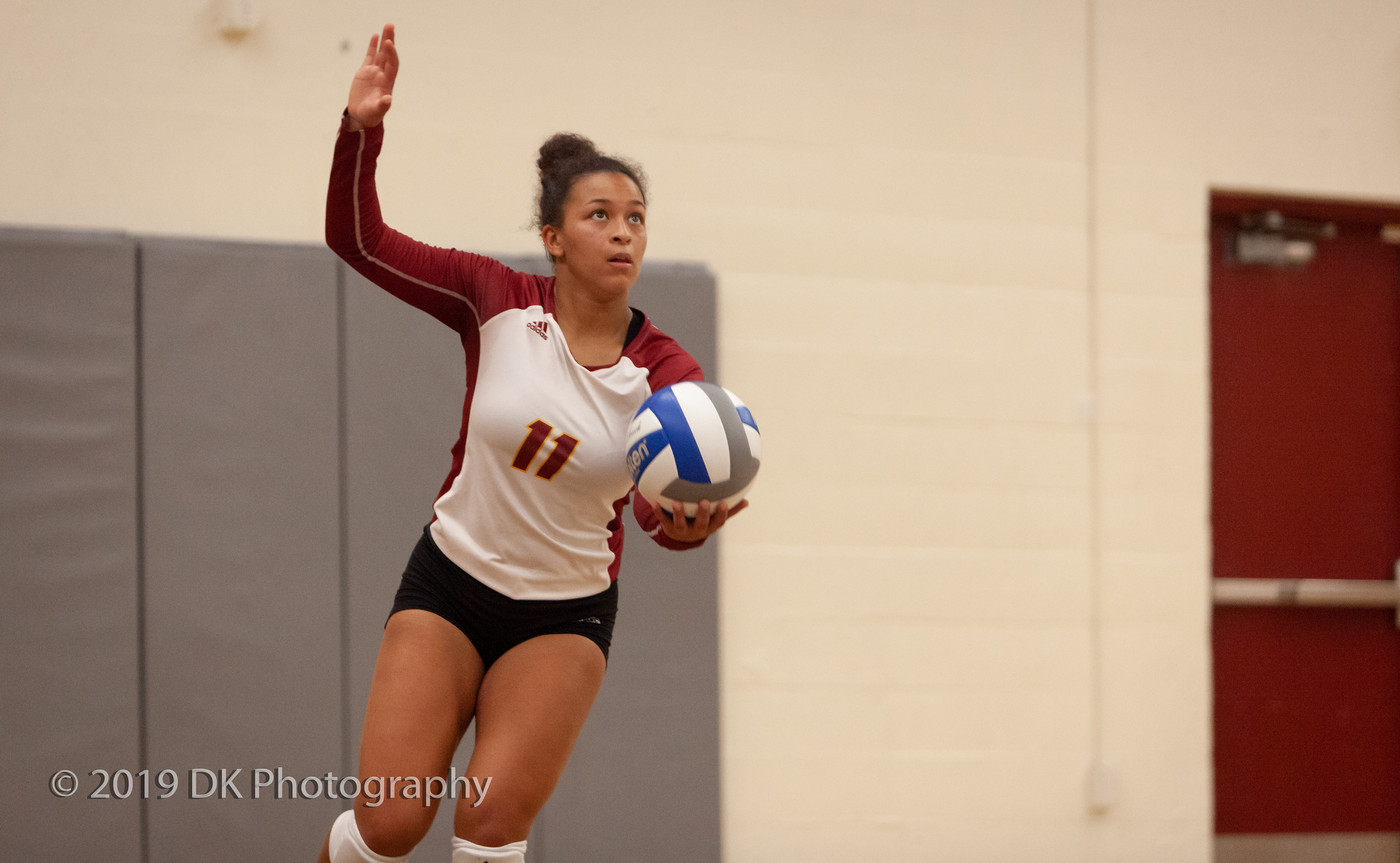 Ashley Ford (#11), City College freshman serves in the match against Feather River College at the North Gym on Aug. 30th.