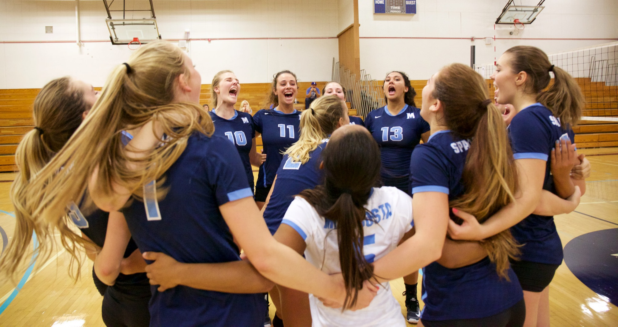 Women's Volleyball Team pre-game cheer.