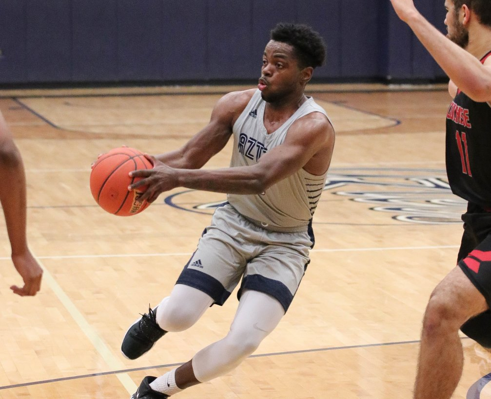 Sophomore Jordan Robinson (Tucson HS) finished with 23 points, eight assists and five rebounds as he went 5 for 8 from three-point range in Pima's 97-87 win over Mesa Community College. The Aztecs have won five straight and moved into a tie for the No. 2 seed in ACCAC Division II. The Aztecs are 16-10 overall and 10-8 in ACCAC conference play. Photo by Stephanie Van Latum