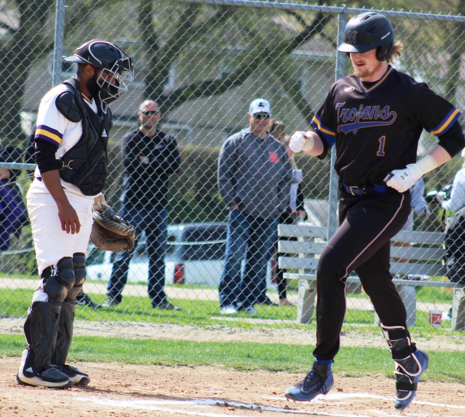 Fox Leum crosses home plate after hitting a home run against Ellsworth last Friday in Iowa Falls.