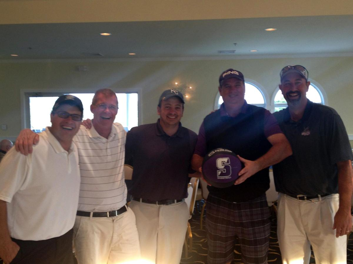 The winners of the 2012 annual men's basketball golf outing, from left, Ryan Alpert, Mike Kerzetski, Mike Manci and P.J. Farrell, pictured with head coach Carl Danzig, right.  This year's tournament is right around the corner, on Friday, September 20, at Stone Hedge