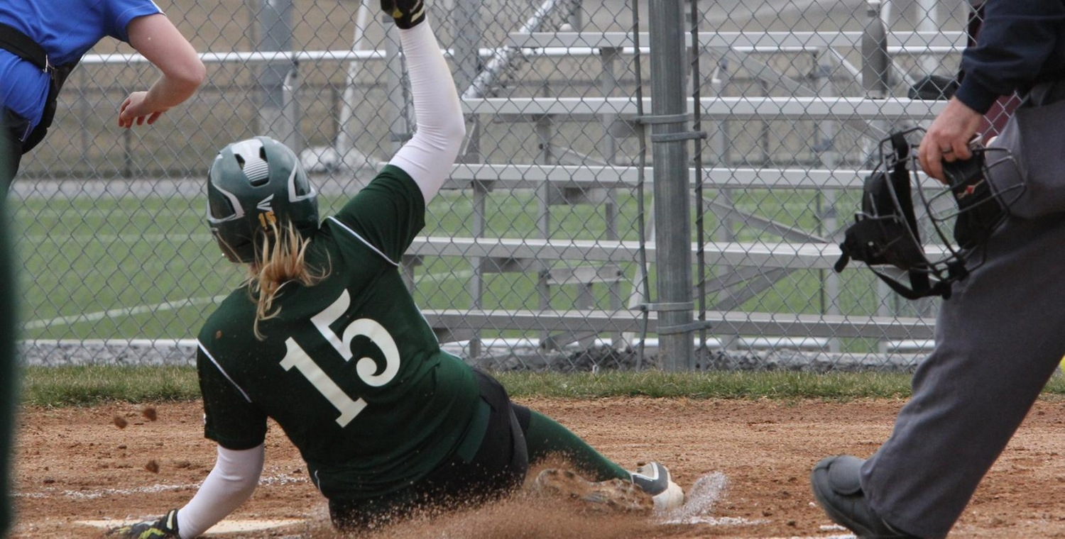 Brittany Vergason (15) sliding into home for Keuka College in Game 1 -- Photo by Ed Webber