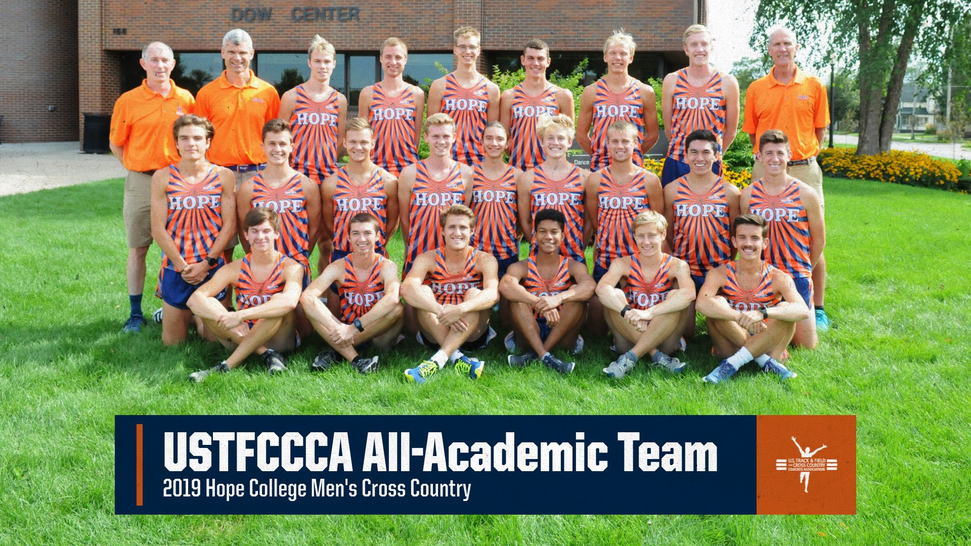 Men's cross country runners pose together for a team portrait.