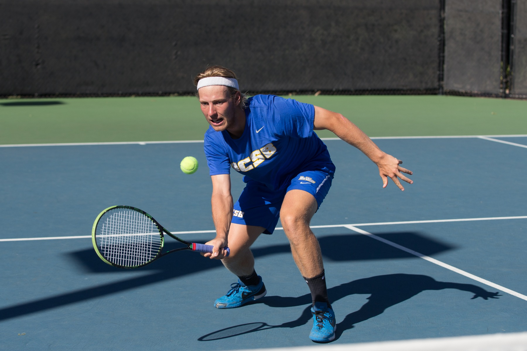 Anders Holm (photo by Eric Isaacs) won both singles and doubles matches for the Gauchos on Thursday.