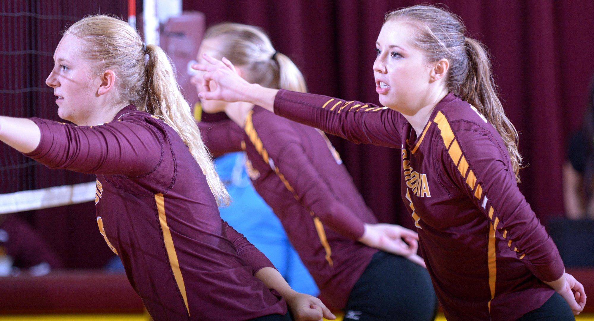 Brianna Carney (L) and Haley Cuppett combined for 22 kills in the Cobbers' match with St. Olaf.