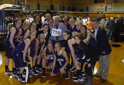 Head coach Mike Strong and the Lady Royals celebrate after defeating Cabrini, 46-43, on Saturday to give Strong his 758th victory, an NCAA Division III women's basketball record. On Monday, Nov. 5, the Pennsylvania State House unanimously adopted a resolution by Representative Sid Michaels Kavulich designating December 1 through December 7, 2012, as Mike Strong Week in Pennsylvania
