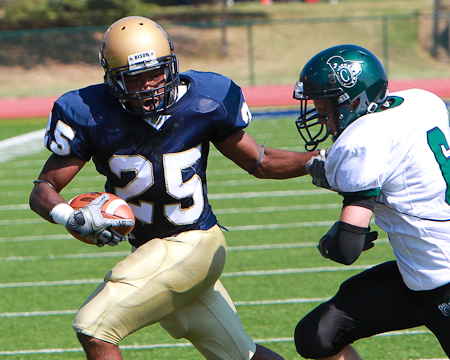 Gallaudet's Phillip Hayes breaks to the outside against a Castleton defender.