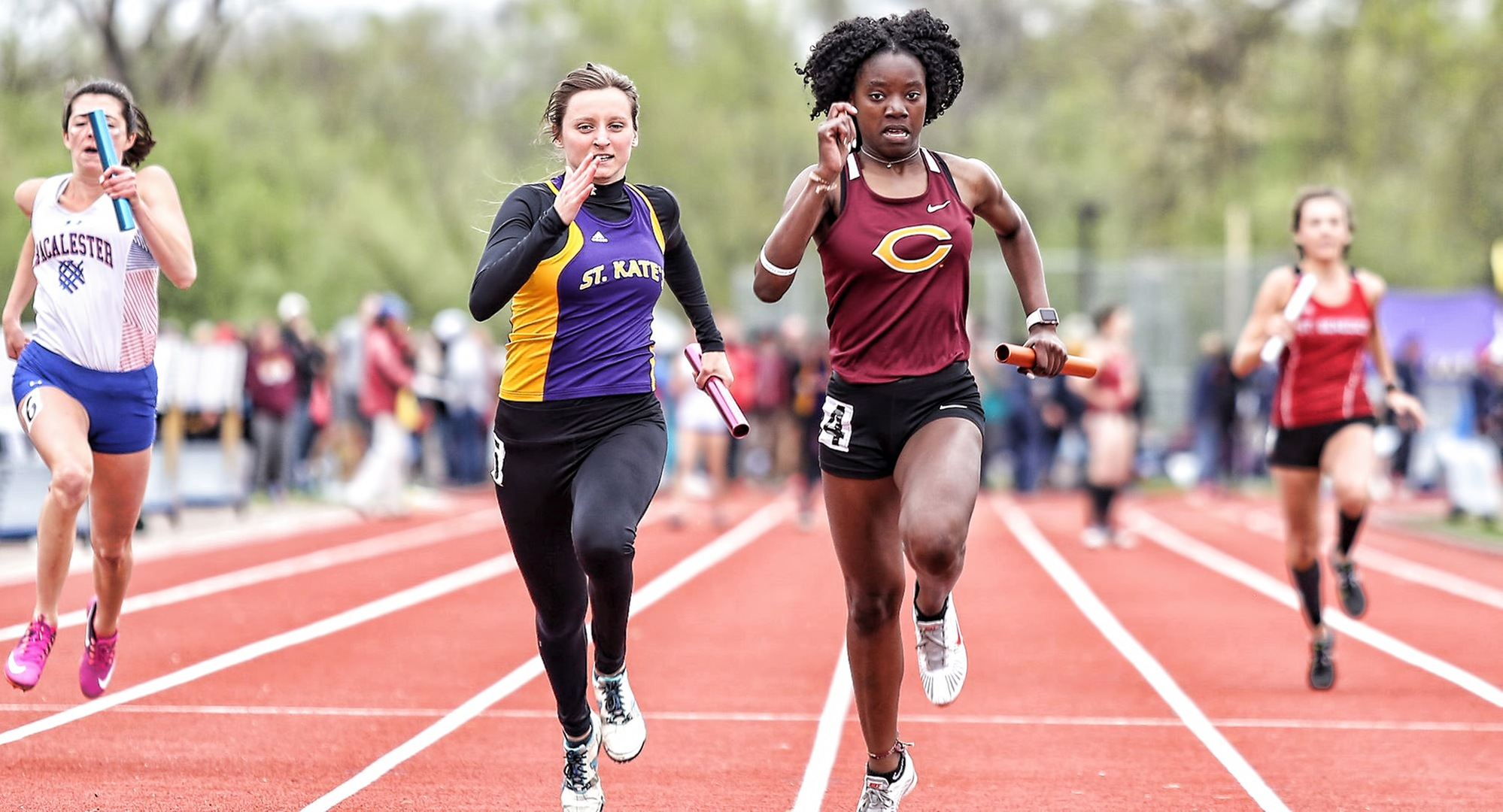 Sophomore Zahra Banks races to the finish line in the 100-meter relay on Day 2 of the MIAC Championship Meet (Photo courtesy of Nathan Lodermeier)