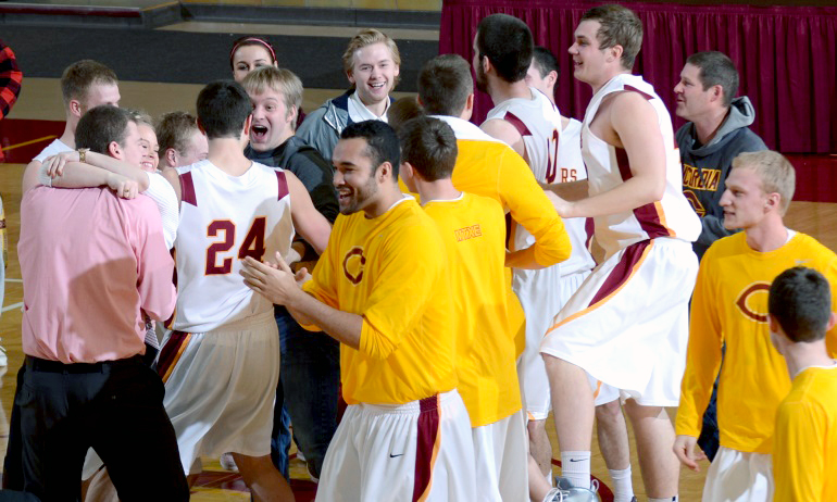 Fans celebrate with members of Concordia after the Cobbers' upset win over No.2-ranked St. Thomas.