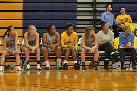 GCC Women's Basketball Team on bench watching game