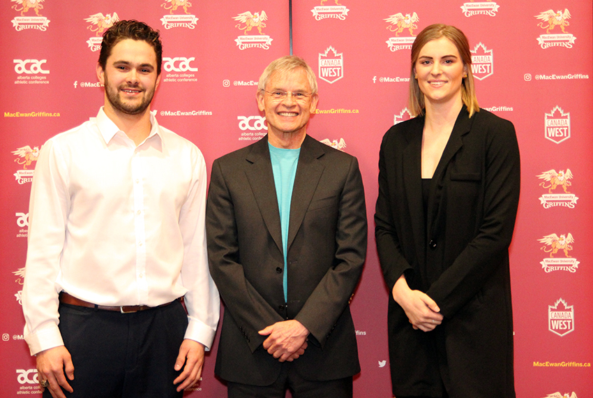 Griffins athletes of the year Brett Njaa (men's hockey), left, and Cassidy Kinsella (women's volleyball), right, pose with MacEwan University Vice-President Academic and Provost John Corlett at the Sutton Place Hotel on Thursday (Ryan Gurnett photo).