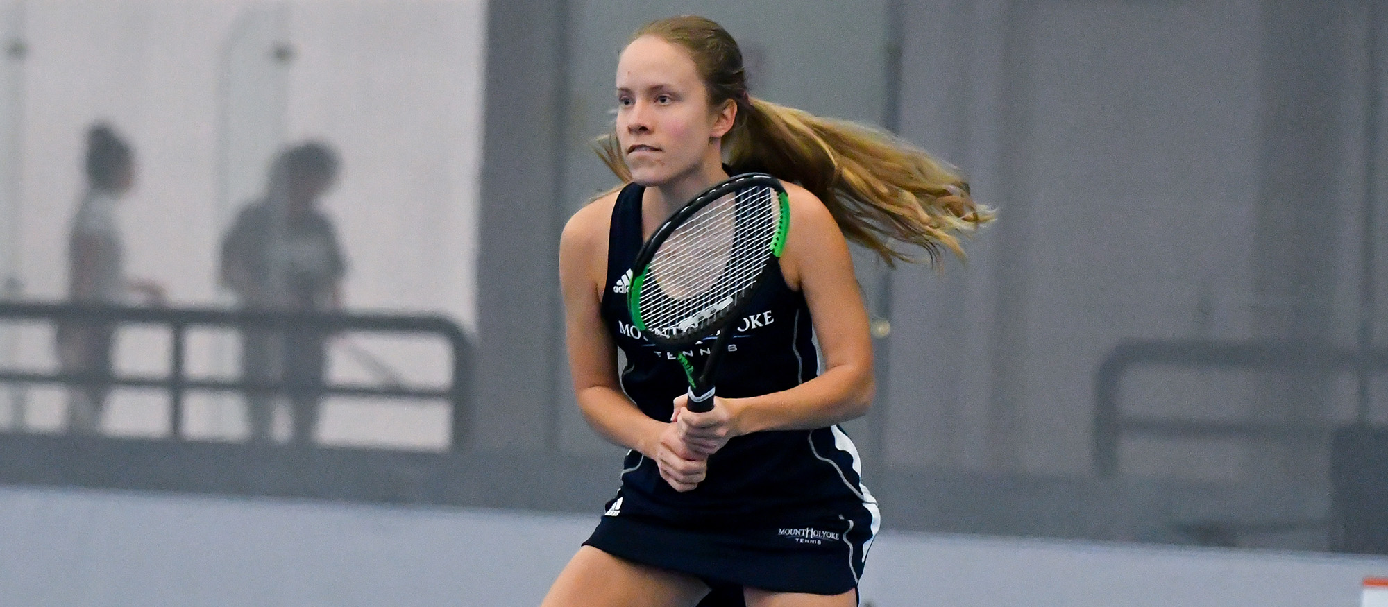 Action photo of Lyons tennis student-athlete, Anya Gerasimova.
