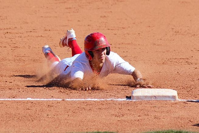 Corey Chaplin slides safely into third base in the first game between Mesa and Benedictine University JV. (photo by Aaron Webster)