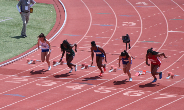 Megan Hudson (left) comes out strong in the 100m hurdles at the NJCAA National Outdoor Championships.