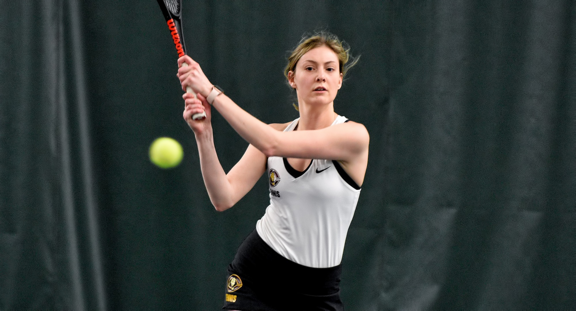 Junior Jenna Forknell eyes her backhand return during her match at No.2 singles in the Cobbers' home opener against St. Catherine.
