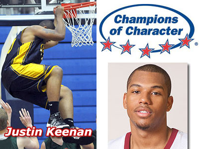 "Justin Keenan hangs on the rim during last week's ""Champions of Character"" All-Star Game (Photo courtesy of Grand Rapids Press - www.grpress.com)"