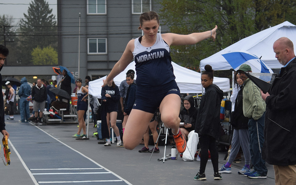 Sophomore Jenevieve Eberly competes in the long jump during the Greyhound Invitational at Timothy Breidegam Track.