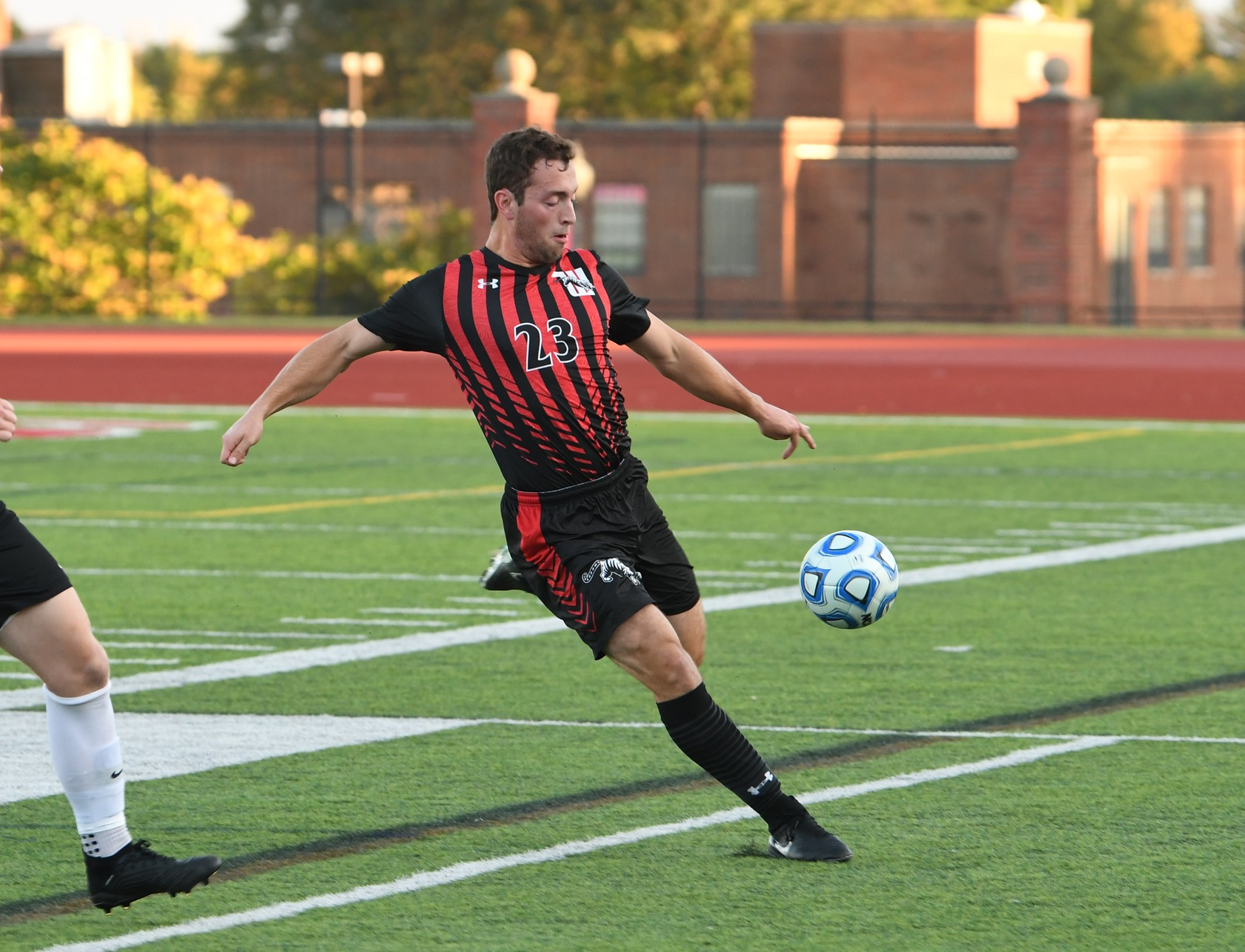 Senior Christian Randazzo clears the ball against Albion. (Nick Falzerano/Wittenberg Athletics)
