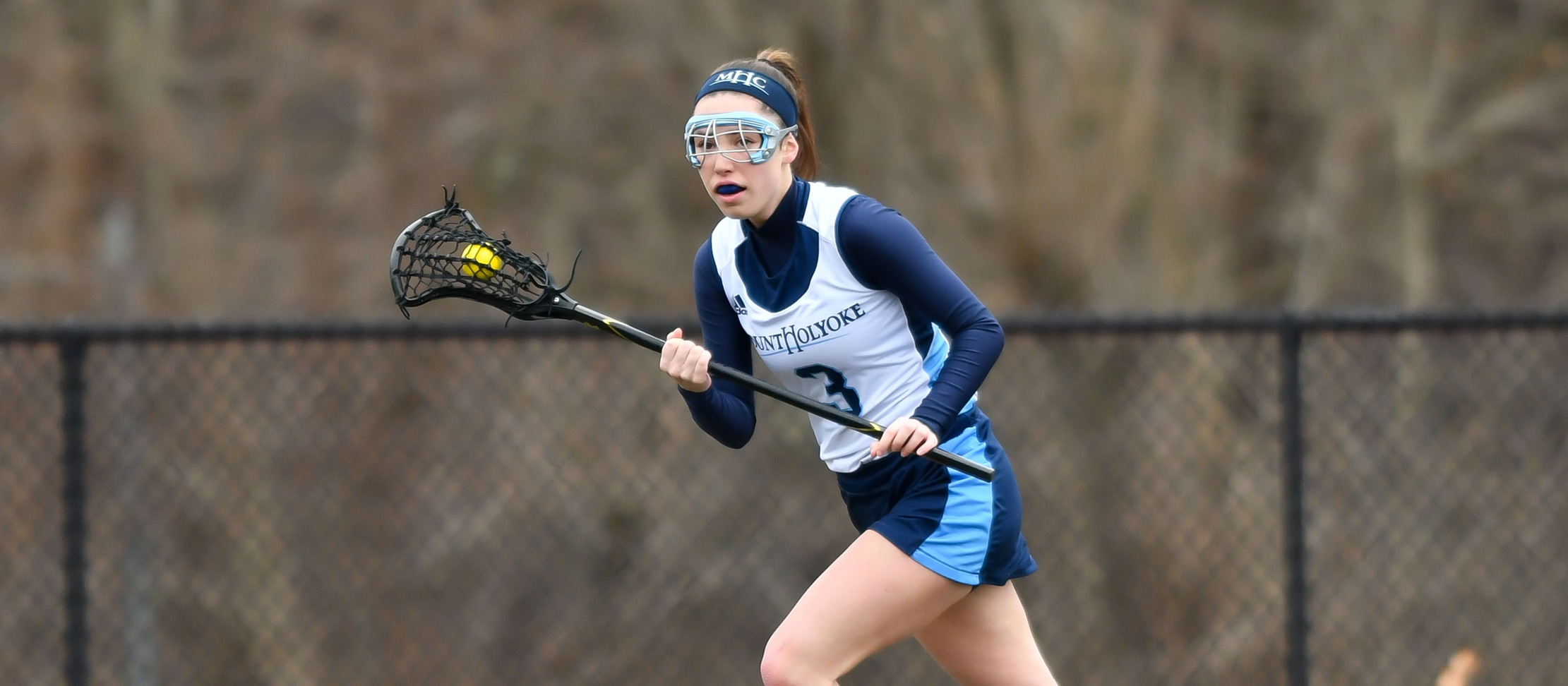 Action photo of junior lacrosse player Mazzie Meotti.