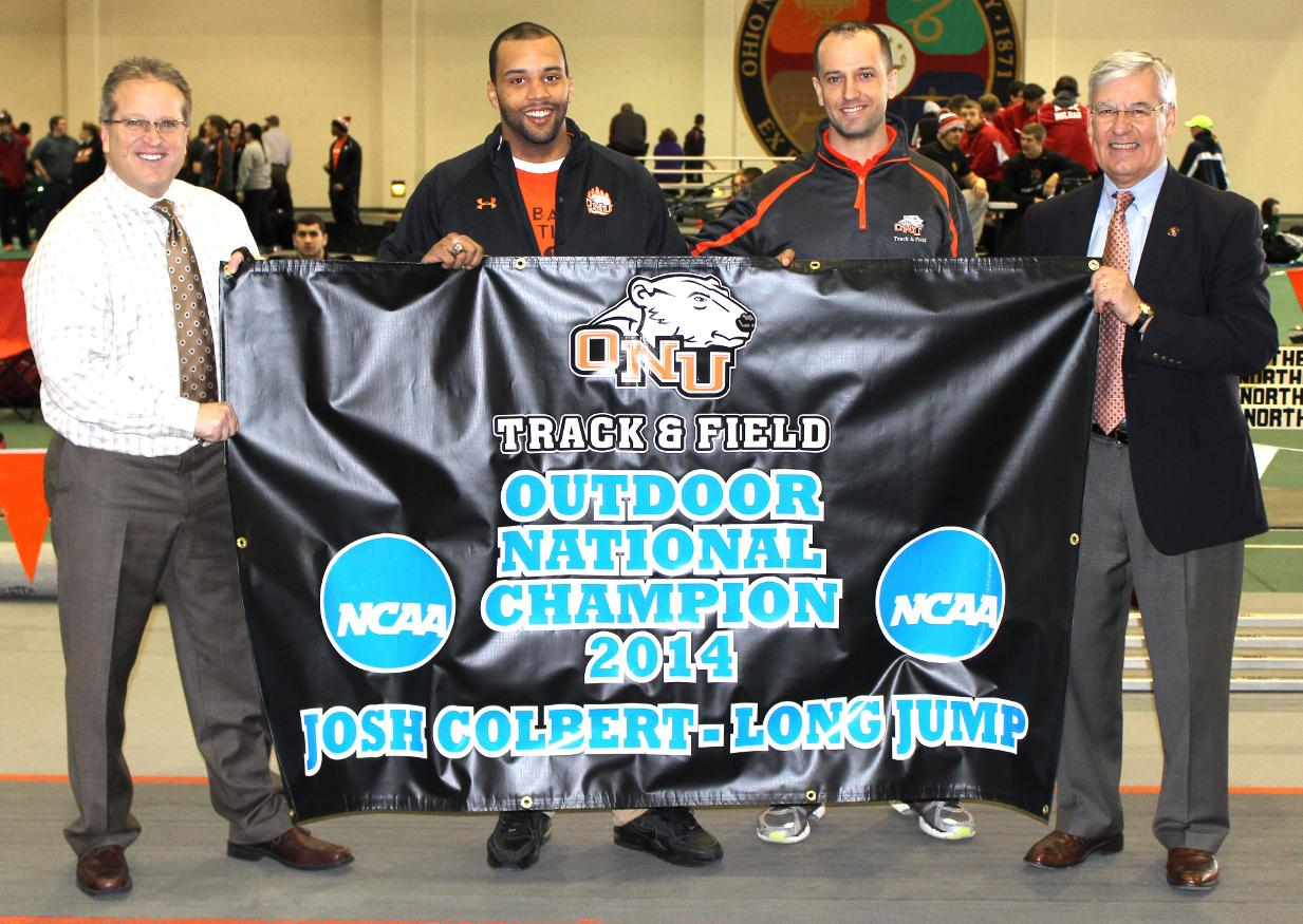 Josh Colbert (2nd from left) is recognized for his long jump national championship. (ONU Sports Information photo/JoseNogueras)