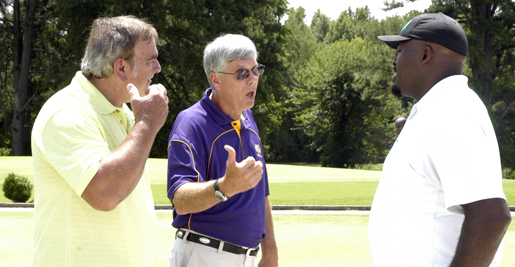 Former NFL Pro Bowler Jim Youngblood (left) and Golden Eagle head coach Watson Brown (center) discuss rules of golf (or something?) with eight-year NFL veteran Frank Omiyale. Photo by Mike Lehman
