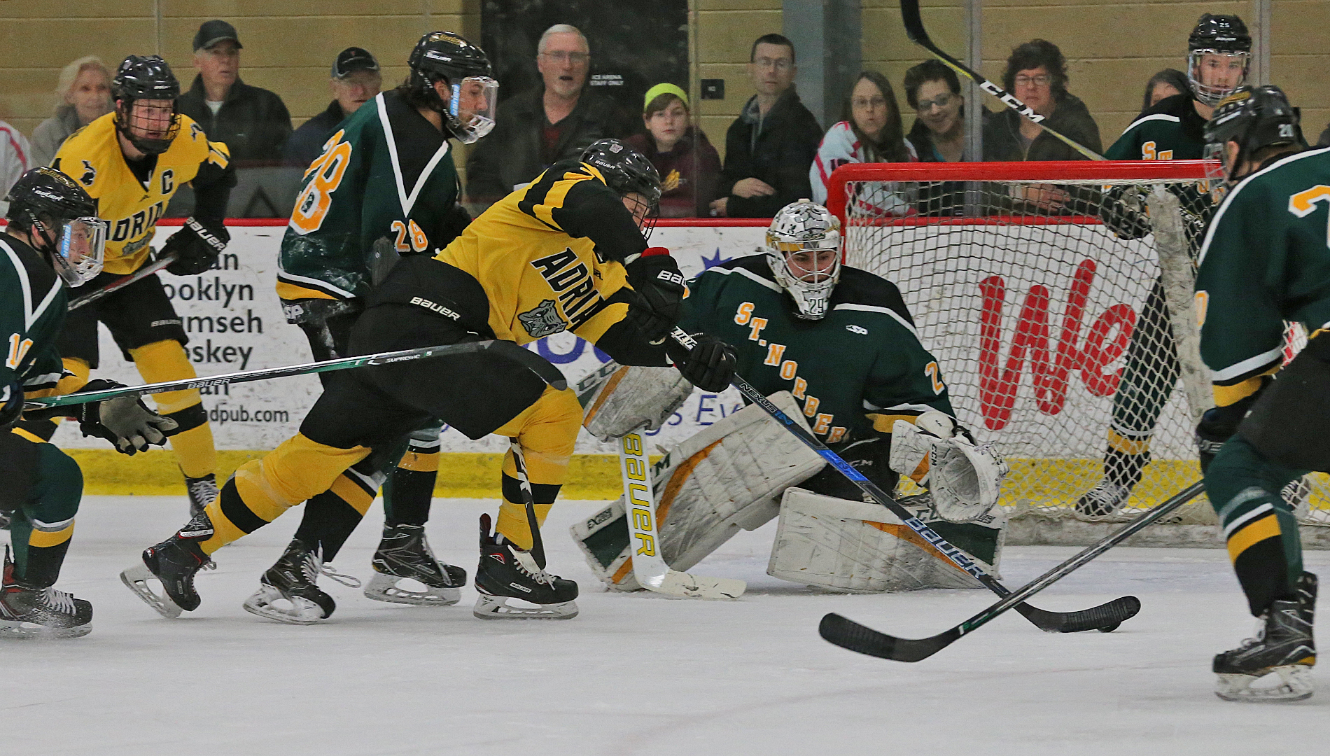 Players battle for positioning in front of the SNC net on Saturday. (Action photo by Mike Dickie)