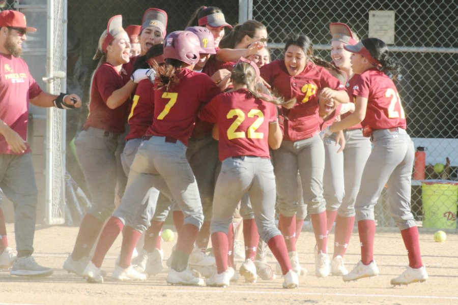 The Lancers mob Amanda Flores after her game-winning hit in the 13th inning v. Chaffey on Tuesday, photo by Richard Quinton.