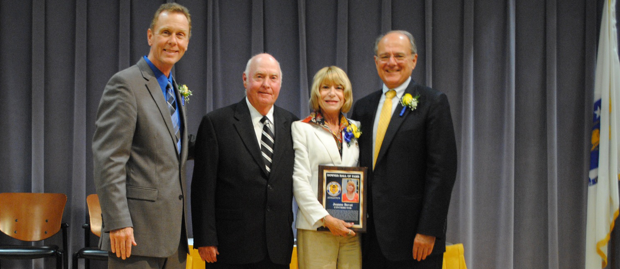 Bovat at the 2011 Downes Athletic Hall of Fame induction ceremony along with (from left) former Athletic Director Mike Theulen, Coach Bill Downes, and University President Dr. Anthony Caprio.